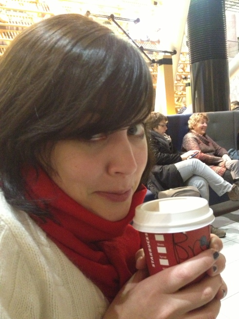 """This is me freezing, but enjoying my complimentary Starbuck's """"cranberry white mocha""""."""