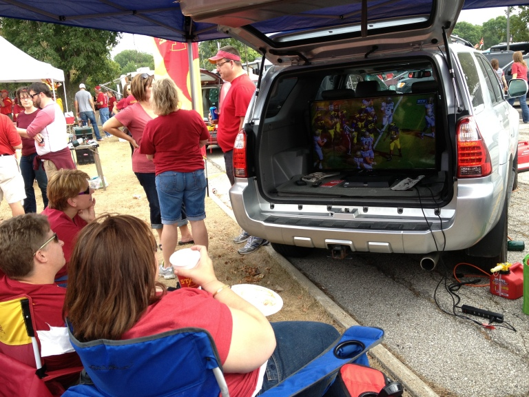 America!  We watch football in the back of our SUV's.